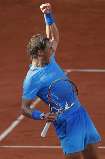 Spain's Rafael Nadal celebrates winning his fourth round match of the French Open tennis tournament against Jack Sock of the U.S. in four sets, 6-3, 6-1, 5-7, 6-2, at the Roland Garros stadium, in Paris, France, Monday, June 1, 2015. (AP Photo/Michel Euler)