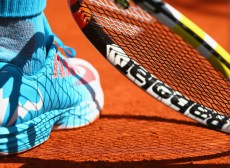 A detailed view of Rafael Nadal of Spain's shoe and raquet ahead of his Men's quarter final match against Novak Djokovic of Serbia on day eleven of the 2015 French Open at Roland Garros on June 3, 2015 in Paris, France. (June 2, 2015 - Source: Clive Brunskill/Getty Images Europe)