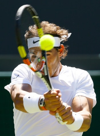 Rafael Nadal of Spain returns a ball to Thomaz Bellucci of Brazil during their singles first round match at the All England Lawn Tennis Championships in Wimbledon, London, Tuesday June 30, 2015. (AP Photo/Kirsty Wigglesworth)