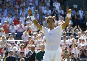 Rafael Nadal of Spain celebrates after defeating Thomaz Bellucci of Brazil in the singles first round match at the All England Lawn Tennis Championships in Wimbledon, London, Tuesday June 30, 2015. Nadal won the match 6-4, 6-2, 6-4.(AP Photo/Kirsty Wigglesworth)
