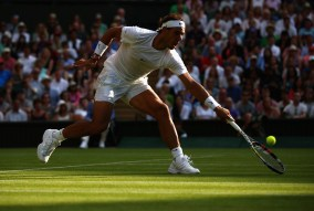 LONDON, ENGLAND - JULY 02: Rafael Nadal of Spain plays a backhand volley in his Gentlemens Singles Second Round match against Dustin Brown of Germany during day four of the Wimbledon Lawn Tennis Championships at the All England Lawn Tennis and Croquet Club on July 2, 2015 in London, England. (Photo by Ian Walton/Getty Images)