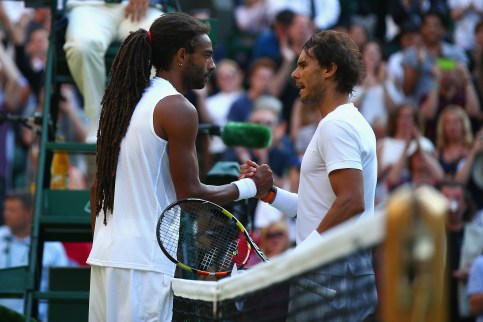 LONDON, ENGLAND - JULY 02: Rafael Nadal (R) of Spain shakes hands with Dustin Brown of Germany after losing his Gentlemens Singles Second Round match during day four of the Wimbledon Lawn Tennis Championships at the All England Lawn Tennis and Croquet Club on July 2, 2015 in London, England. (Photo by Ian Walton/Getty Images)