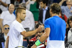 MONTREAL, ON - AUGUST 13: Mikhail Youzhny of Russia congratulates Rafael Nadal of Spain on his victory during day four of the Rogers Cup at Uniprix Stadium on August 13, 2015 in Montreal, Quebec, Canada. Rafael Nadal defeated Mikhail Youzhny 6-3, 6-3. (Photo by Minas Panagiotakis/Getty Images)