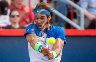 Rafael Nadal, of Spain, returns to Sergiy Stakhovsky, of Ukraine, during the Rogers Cup men's tennis tournament, Wednesday, Aug. 12, 2015, in Montreal. (Paul Chiasson/The Canadian Press via AP) MANDATORY CREDIT