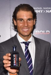 NEW YORK, NY - AUGUST 25: Professional tennis player Rafael Nadal holds a bottle of his new fragrance as he makes a personal appearance at Macy's Herald Square at on August 25, 2015 in New York City. (Photo by Mike Coppola/Getty Images for Tommy Hilfiger)