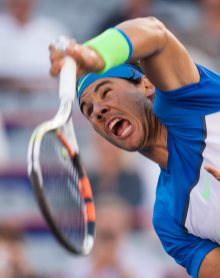 Rafael Nadal, of Spain, serves to Mikhail Youzhny, of Russia, during a Rogers Cup tennis match, Thursday, Aug. 13, 2015, in Montreal. (Paul Chiasson/The Canadian Press via AP) MANDATORY CREDIT