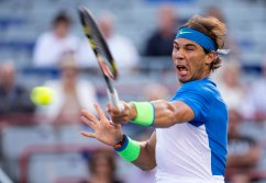Rafael Nadal, of Spain, returns to Mikhail Youzhny, of Russia, during a Rogers Cup tennis match, Thursday, Aug. 13, 2015, in Montreal. (Paul Chiasson/The Canadian Press via AP) MANDATORY CREDIT