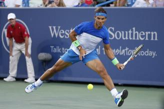 Rafael Nadal, of Spain, returns the ball to Feliciano Lopez, of Spain, at the Western & Southern Open tennis tournament, Thursday, Aug. 20, 2015, in Mason, Ohio. (AP Photo/John Minchillo)