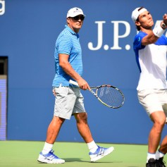 August 25, 2015 – Toni Nadal, left, looks on as Rafael Nadal practices for the 2015 US Open at the Billie Jean King National Tennis Center in Flushing, NY. - USTA/Steven Ryan