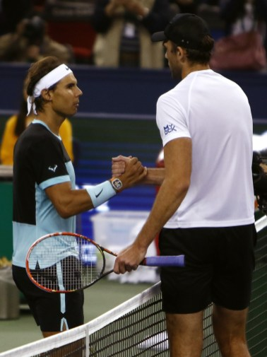 SHANGHAI, CHINA - OCTOBER 14: Rafael Nadal of Spain shakes hand with Ivo Karlovic of Croatia after he won the match in men's singles second round match on day 4 of Shanghai Rolex Masters at Qi Zhong Tennis Centre on October 14, 2015 in Shanghai, China. (Photo by Kevin Lee/Getty Images)