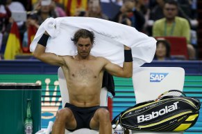 Rafael Nadal of Spain changes his shirt during a break during his men's singles quarter-final match against Stan Wawrinka of Switzerland at the Shanghai Masters tennis tournament in Shanghai, China, October 16, 2015. REUTERS/Aly Song