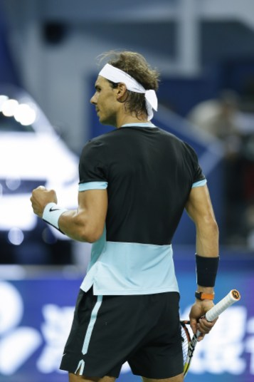 SHANGHAI, CHINA - OCTOBER 16: Rafael Nadal of Spain winning his men's singles quarterfinals match against Stan Wawrinka of Switzerland on day 6 of Shanghai Rolex Masters at Qi Zhong Tennis Centre on October 16, 2015 in Shanghai, China (Photo by Lintao Zhang/Getty Images)