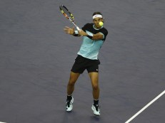 SHANGHAI, CHINA - OCTOBER 17: Rafael Nadal of Spain returns a shot against Jo-Wilfried Tsonga of France in his men's singles semifinals match on day 7 of Shanghai Rolex Masters at Qi Zhong Tennis Centre on October 17, 2015 in Shanghai, China. (Photo by Kevin Lee/Getty Images)