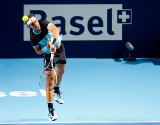 Rafael Nadal of Spain serves a ball against Czech Republic's Lukas Rosol during their match at the Swiss Indoors ATP men's tennis tournament in Basel, Switzerland October 26, 2015. REUTERS/Arnd Wiegmann