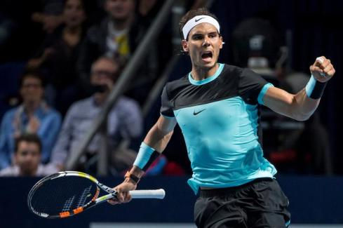 Spain's Rafael Nadal jubilates after returning a ball to Croatia's Marin Cilic during their quarter final match at the Swiss Indoors tennis tournament at the St. Jakobshalle in Basel, Switzerland, Friday, Oct. 30, 2015. (Alexandra Wey/Keystone via AP)