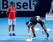 Rafael Nadal of Spain cleans a line during his match against Croatia's Marin Cilic at the Swiss Indoors ATP men's tennis tournament in Basel, Switzerland October 30, 2015. REUTERS/Arnd Wiegmann