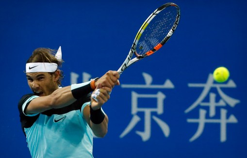 Rafael Nadal of Spain hits a return while playing against Novak Djokovic of Serbia in their men's singles final match in the China Open tennis tournament at the National Tennis Stadium in Beijing, Sunday, Oct. 11, 2015. (AP Photo/Mark Schiefelbein)