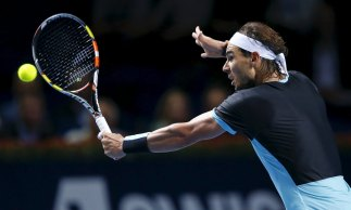 Rafael Nadal of Spain returns the ball to France's Richard Gasquet during their semi-final match at the Swiss Indoors ATP men's tennis tournament in Basel, Switzerland, October 31, 2015. REUTERS/Arnd Wiegmann