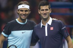 "Rafael Nadal of Spain (L) and Novak Djokovic of Serbia pose for photograph before their ""Back To Thailand - Nadal vs Djokovic"" friendly tennis match in Bangkok, Thailand, October 2, 2015. REUTERS/Athit Perawongmetha"