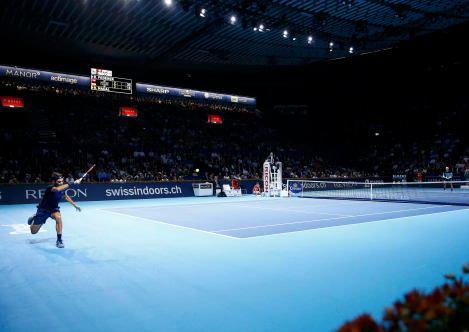 Switzerland's Roger Federer (L) returns a ball to Rafael Nadal of Spain during their match at the Swiss Indoors ATP men's tennis tournament in Basel, Switzerland November 1, 2015. REUTERS/Arnd Wiegmann