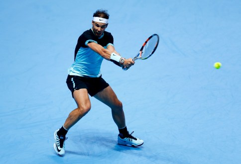 LONDON, ENGLAND - NOVEMBER 18: Rafael Nadal of Spain plays a backhand in his men's singles match against Andy Murray of Great Britain during day four of the Barclays ATP World Tour Finals at the O2 Arena on November 18, 2015 in London, England. (Photo by Julian Finney/Getty Images)