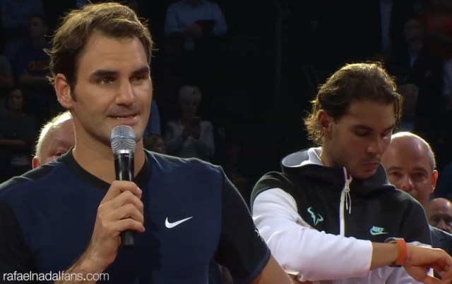 Rafael Nadal checks his watch during Roger Federer victory speech at Swiss Indoors Basel 2015