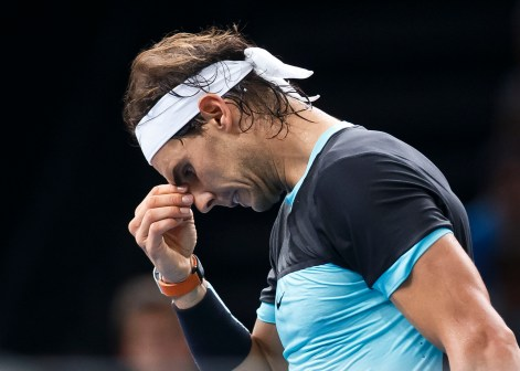 Rafael Nadal of Spain reacts after losing point against Kevin Anderson of South Africa during their third round match of the BNP Masters tennis tournament at the Paris Bercy Arena, in Paris, France, Thursday, Nov. 5, 2015. (AP Photo/Michel Euler)