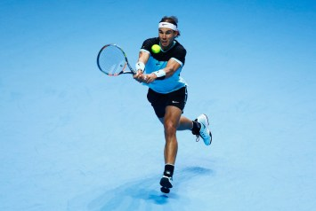 Rafael Nadal of Spain plays a backhand in his men's singles match against Stanislas Wawrinka of Switzerland during day two of the Barclays ATP World Tour Finals at O2 Arena on November 16, 2015 in London, England. (Nov. 15, 2015 - Source: Julian Finney/Getty Images Europe)
