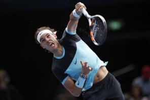Rafael Nadal of Spain serves the ball to Switzerland's Stan Wawrinka during their quarterfinal match of the BNP Masters tennis tournament, at Bercy Arena, in Paris, France, Friday, Nov. 6, 2015. (AP Photo/Francois Mori)