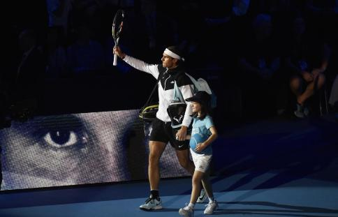 Tennis - Barclays ATP World Tour Finals - O2 Arena, London - 16/11/15 Men's Singles - Spain's Rafael Nadal with a mascot before his match against Switzerland's Stanislas Wawrinka Reuters / Toby Melville Livepic EDITORIAL USE ONLY.