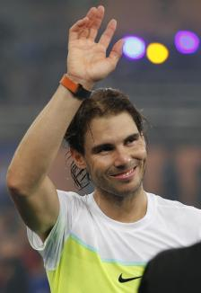 Rafael Nadal of the Indian Aces waves at supporters during the International Premier Tennis League in New Delhi, India, Saturday, Dec. 12, 2015. (AP Photo /Tsering Topgyal)