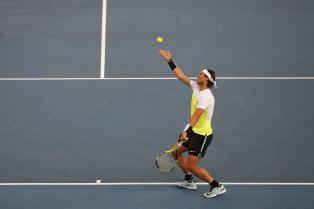 Rafael Nadal of the Indian Aces serves against Roger Federer and Marin Cilic of UAE Royals in the men's doubles event of the International Premier Tennis League in New Delhi, India, Saturday, Dec. 12, 2015. (AP Photo /Tsering Topgyal)