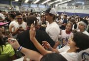Spain's Rafael Nadal, center, walks as his fans take his pictures during a tennis clinic in Makati, south of Manila, Philippines Sunday, Dec. 6, 2015. Nadal is in the country to promote his tennis academy and to compete in the International Premier Tennis League (IPTL). (AP Photo/Aaron Favila)