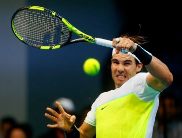 Spain's Rafael Nadal of the Indian Aces returns a shot to Canada's Milos Raonic of the Philippine Mavericks during the men's singles match of the 2015 International Premier Tennis League Tuesday, Dec. 8, 2015, at the Mall of Asia Arena at suburban Pasay city south of Manila, Philippines. Nadal won the thrilling shootout 6-5 (7/6). (AP Photo/Bullit Marquez)