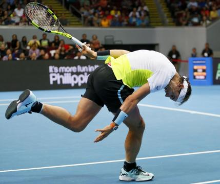 Spain's Rafael Nadal of the Indian Aces fails to return a shot to Czech Republic's Tomas Berdych of the UAE Royals during their men's singles match in the International Premier Tennis League Monday, Dec. 7, 2015 at the Mall of Asia Arena in Pasay city, south of Manila, Philippines. Nadal won 6-5. (AP Photo/Bullit Marquez)