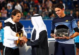 Spain's Rafael Nadal (L) is congratulated by Sheikh Nahyan Bin Mubarak Al Nahyan (C), head of the UAE Ministry of Culture, Youth, and Social Development, after defeating Milos Raonic (R) of Canada in their final match of the Mubadala World Tennis Championship in Abu Dhabi, United Arab Emirates, 02 January 2016. (Tenis) EFE/EPA/ALI HAIDER