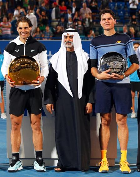 Spain's Rafael Nadal (L) poses with his trophy next to Sheikh Nahyan Bin Mubarak Al Nahyan (C), head of the UAE Ministry of Culture, Youth, and Social Development, after defeating Milos Raonic (R) of Canada in their final match of the Mubadala World Tennis Championship in Abu Dhabi, United Arab Emirates, 02 January 2016. (Tenis) EFE/EPA/ALI HAIDER