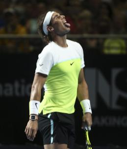 Rafael Nadal of Spain pokes his tongue out during his match against Lleyton Hewitt of Australia in the Fast4 tennis tournament in Sydney, Australia, Monday, Jan. 11, 2016.(AP Photo/Rob Griffith)