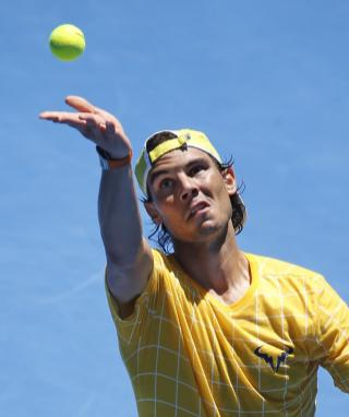 Rafael Nadal of Spain tosses the ball for a serve during a practice session, ahead of the Australian Open tennis championships in Melbourne, Australia, Saturday, Jan. 16, 2016.(AP Photo/Vincent Thian)
