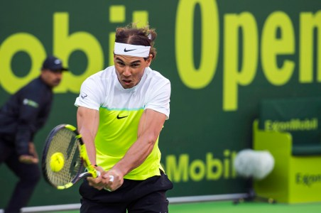Spain's Rafael Nadal partnered by Fernando Verdasco of Spain, successfully returns the ball during the men's doubles match against Teymuraz Gabashvili of Russia and Albert Ramos of Spain at the Qatar Open in Doha, Qatar, Monday, Jan. 4, 2016. (AP Photo/Alexandra Panagiotidou)