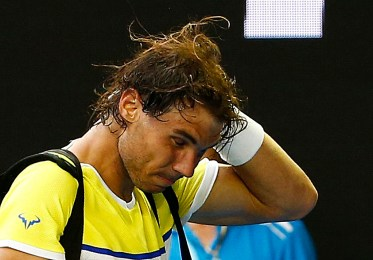 Spain's Rafael Nadal reacts as he leaves after losing his first round match against Spain's Fernando Verdasco at the Australian Open tennis tournament at Melbourne Park, Australia, January 19, 2016. REUTERS/Thomas Peter