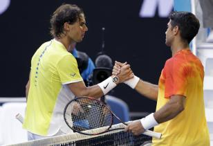 Rafael Nadal, left, of Spain congratulates compatriot Fernando Verdasco after their first round match at the Australian Open tennis championships in Melbourne, Australia, Tuesday, Jan. 19, 2016.(AP Photo/Aaron Favila)