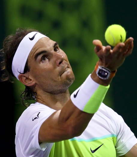 Rafael Nadal of Spain serves to Pablo Carreno Busta of Spain during their Qatar Open men's single tennis match in Doha, Qatar, January 5, 2016. REUTERS/Ibraheem Al Omari