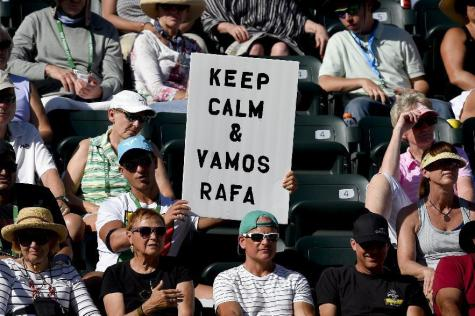 A fan supporting Rafael Nadal, of Spain, holds a sign as Nadal plays Fernando Verdasco, of Spain, during the BNP Paribas Open tennis tournament, Tuesday, March 15, 2016, in Indian Wells, Calif. (AP Photo/Mark J. Terrill)