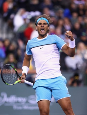 Rafael Nadal of Spain celebrates defeating Gilles Muller of Luxembourg during day seven of the BNP Paribas Open at Indian Wells Tennis Garden on March 13, 2016 in Indian Wells, California. (March 12, 2016 - Source: Julian Finney/Getty Images North America)