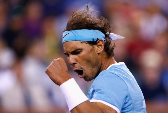 Rafael Nadal of Spain celebrates winning a game against Gilles Muller of Luxembourg during day seven of the BNP Paribas Open at Indian Wells Tennis Garden on March 13, 2016 in Indian Wells, California. (March 12, 2016 - Source: Julian Finney/Getty Images North America)