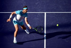 INDIAN WELLS, CA - MARCH 16: Rafael Nadal of Spain hits a forehand volley during his match against Alexander Zverev of Germany at Indian Wells Tennis Garden on March 16, 2016 in Indian Wells, California. (Photo by Harry How/Getty Images)