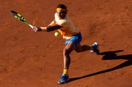 BARCELONA, SPAIN - APRIL 24: Rafael Nadal of Spain plays a backhand against Kei Nishikori of Japan during their final match during day seven of the Barcelona Open Banc Sabadell at the Real Club de Tenis Barcelona on April 24, 2016 in Barcelona, Spain. (Photo by Alex Caparros/Getty Images)