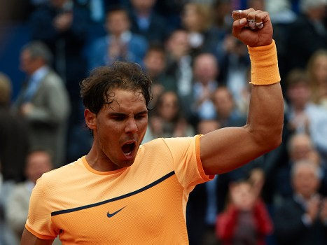 BARCELONA, SPAIN - APRIL 22: Rafael Nadal of Spain celebrates defeating Fabio Fognini of Italy during day five of the Barcelona Open Banc Sabadell at the Real Club de Tenis Barcelona on April 22, 2016 in Barcelona, Spain. (Photo by Manuel Queimadelos Alonso/Getty Images)