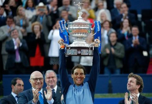 Spain's Rafael Nadal lifts the trophy after winning the Barcelona Open tennis tournament in Barcelona, Spain, Sunday, April 24, 2016. Spain's Rafael Nadal defeated Japan's Kei Nishikori 6-4 and 7-5, in the final. (AP Photo/Manu Fernandez)